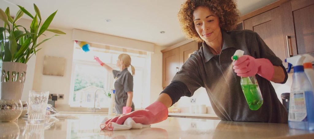 maid cleaning counters